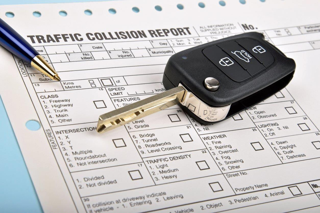 car keys on top of traffic collision report