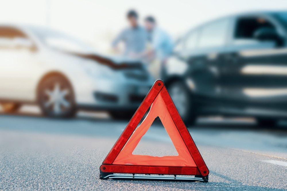 road side folding safety triangle in front of collision