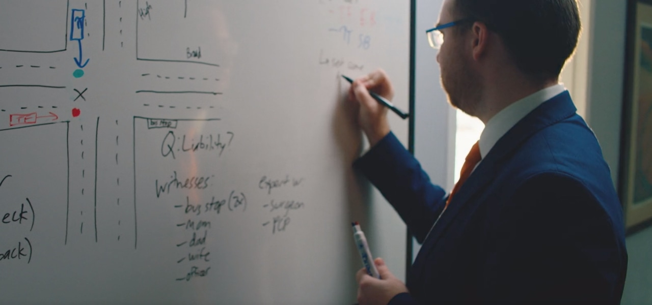 Adam Morris writing on white board